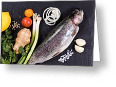 Fresh Whole Raw Fish And Herbs Displayed On Natural Slate Stone  Greeting Card