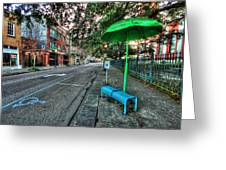 Green Umbrella Bus Stop Greeting Card by Michael Thomas
