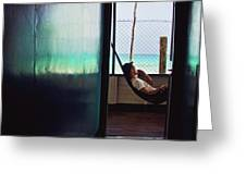 Guy With The Hat Lying In A Hammock On The Porch Of The Old House And Relaxing By The Caribbean Sea Greeting Card
