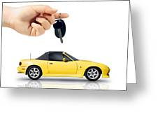 Hand Holding Key To Yellow Sports Car Greeting Card