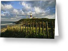 Lighthouse At Montauk With Dramatic Sky Greeting Card by Skip Brown