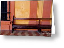 Long Wooden Bench Against A Yellow Wall At The Alcazar Of Seville Greeting Card
