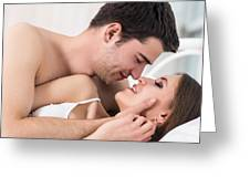 Loving Couple In Bed. Greeting Card