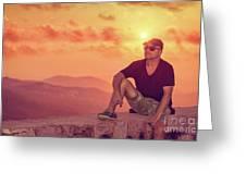 Man Enjoying Sunset Greeting Card