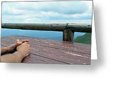 Man Hands On A Wooden Table Outside, With Cloudy Sky  by Oana Unciuleanu