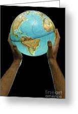 Man Holding Illuminated Earth Globe Greeting Card