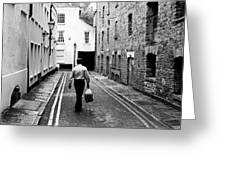 Man Walking With Shopping Bag Down Narrow English Street Greeting Card