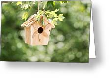 New Wooden Birdhouse Hanging On Tree Branch Outdoors  Greeting Card