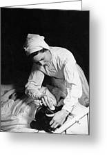 Nurse Tending To A Patient Greeting Card