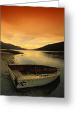 Old Rowboat At Waters Edge With Sunset Greeting Card by Don Hammond