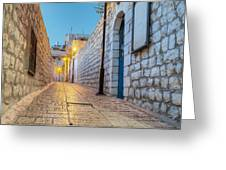 Old Stone Alleyway With Electric Lights Greeting Card by Noam Armonn