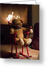 Old Teddy Bear Sitting Front Of The Fireplace In A Cold Night Greeting Card