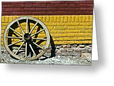 Old Wooden Wheel Against A Wall Greeting Card