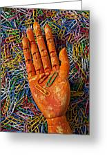 Orange Wooden Hand Holding Paperclips Greeting Card