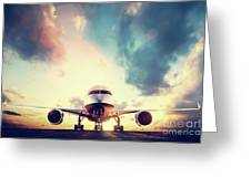 Passenger Airplane Taking Off On Runway At Sunset Greeting Card