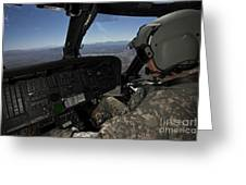 Pilot Operating The Cockpit Of A Uh-60 Greeting Card
