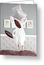 Playful Young Woman Jumping On The Bed , A Pillow Fight Greeting Card