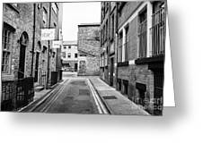red brick buildings in narrow back turner street Northern quarter Manchester uk Greeting Card