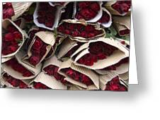 Red Roses Wrapped In Paper Displayed Greeting Card