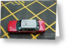 Red Taxi Cab Driving Over Yellow Lines In Hong Kong Greeting Card
