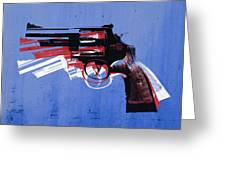 Revolver On Blue Greeting Card by Michael Tompsett