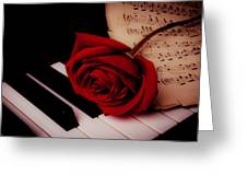 Rose With Sheet Music On Piano Keys Greeting Card