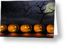 Row Of Halloween Pumpkins In A Spooky Forest At Night Greeting Card