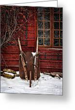 Rusty Wheelbarrow Leaning Against Barn In Winter Greeting Card by Sandra Cunningham