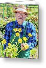 Senior Gardener Showing A Potted Flower. Greeting Card
