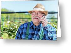 Senior Gardener Talking On The Phone With A Client. Greeting Card