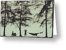 Silhouette Of A Young Men With Crossed Hands Above His Head Camping Hammocking In The Nature Greeting Card