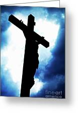 Silhouetted Crucifix Against A Cloudy Sky Greeting Card