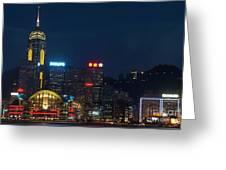 Skyline Illuminated At Night From Kowloon Greeting Card by Sami Sarkis