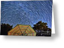 Star Trails Over The Umbrellas Greeting Card