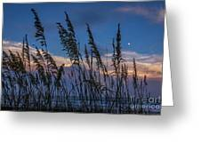 Sunset And Moonrise Over The Ocean Greeting Card
