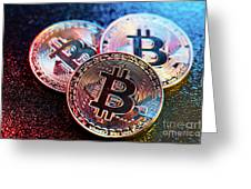Three Bitcoin Coins In A Colorful Lighting. Greeting Card