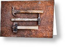 Three Hammers Against A Rust Background Greeting Card