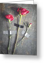 Three Red Flowers Taped To Wooden Background Greeting Card