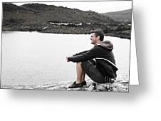 Tourist Seated At Dove Lake Lookout In Tasmania Greeting Card