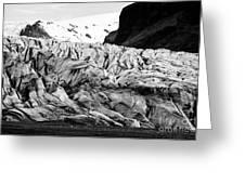 tourists at ash covered Skaftafell glacier and end moraine Vatnajokull national park in Iceland Greeting Card