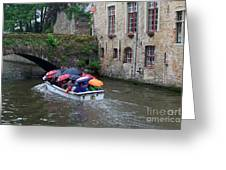 Tourists With Umbrellas In A Sightseeing Boat On The Canal In Bruges Greeting Card