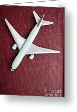 Toy Airplane Over Red Book Cover Greeting Card