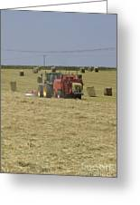 Tractor Bailing Hay In A Field At Harvest Time Pt Greeting Card