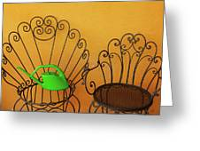 Two Black Iron Chairs And A Green Watering-can  Laid  On The Big Greeting Card