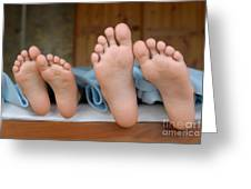 Two Children Lying In Bed Focus On Feet Greeting Card