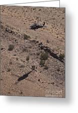 Uh-60 Black Hawk Hovers Above U.s Greeting Card