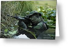 U.s. Navy Seal Crosses Through A Stream Greeting Card