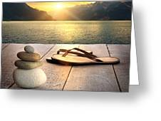 View Of Sandals And Rocks On Dock  Greeting Card