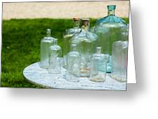 Vintage Glass Bottles On Table Greeting Card