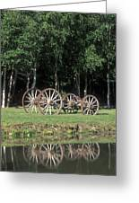 Wagon Wheels Reflecting In A Pond Greeting Card
